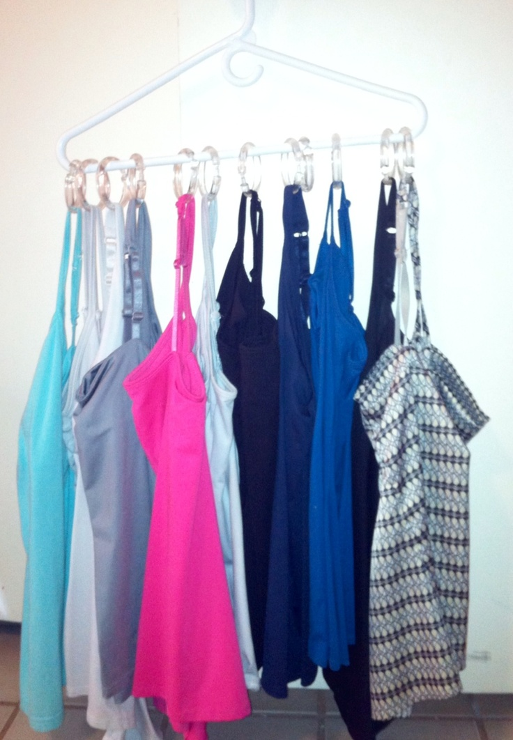 Cami Hanger...Use Dollar Tree shower curtain hangers and attach to a hanger. You don't even have to clamp the hanger shut! just slide onto the hanger and slide on your tank! super easy to put on and take off! I am always losing my tanks in the closet and this has helped me utilize closet space and find my tanks in a hurry!