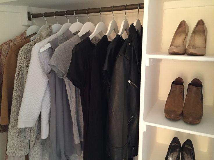 A walk-in wardrobe with sliding doors in Blackheath