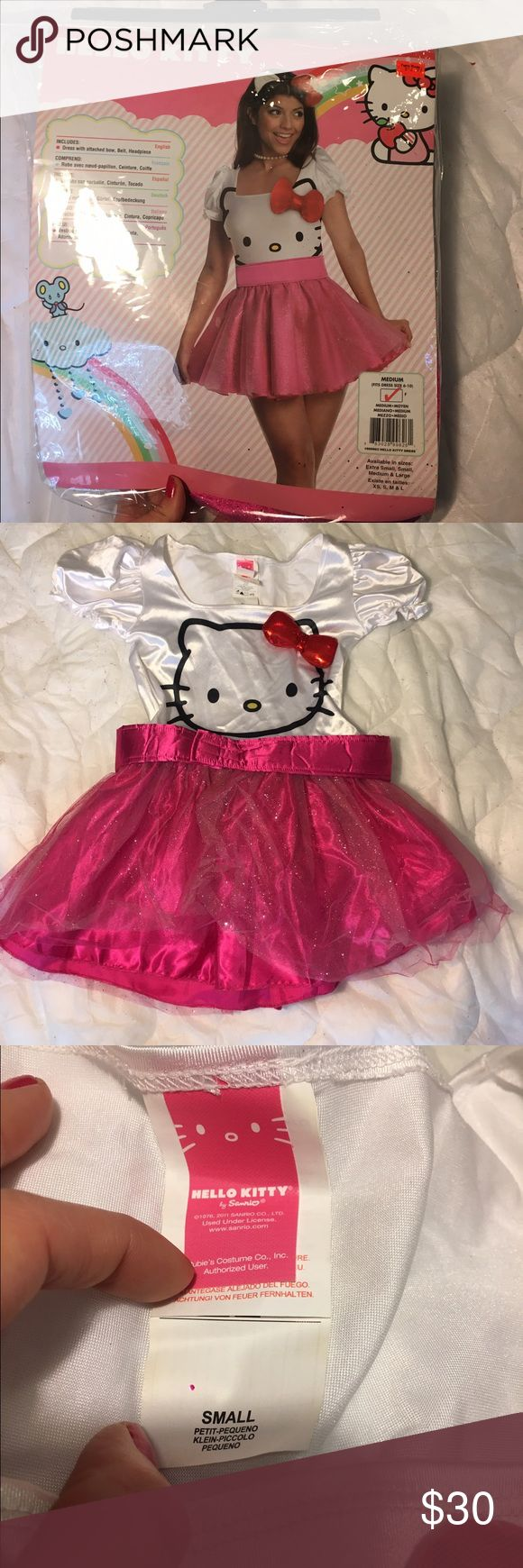 Hello Kitty Outfit Good Condition, worn once, this is a size small and comes with dress and band Hello Kitty Dresses Mini