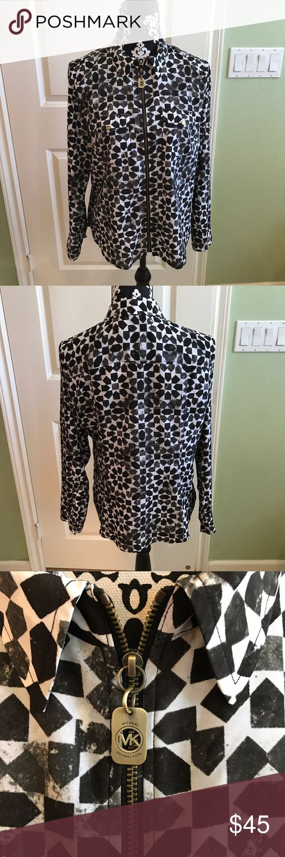 Micheal Kors Zip up blouse Like new worn once has a full working zipper front can be worn as a blouse or jacket no rips stains or tears Michael Kors Tops Blouses