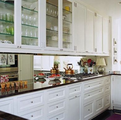 MIRRORED BACKSPLASH Trick of the Eye - Galley Kitchen Design Ideas - Bob Vila A design element frequently employed by decorators, the mirrored backsplash in this kitchen makes a confined room feel more expansive by reflecting any natural light back into the narrow space.