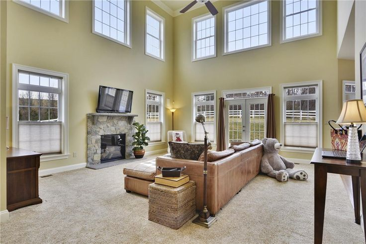 The family room at 13117 Piney Meetinghouse Rd is amazing. With a high ceiling, large ceiling fan, beautiful stone fireplace and loads of windows! http://www.jeremyhomes.com/listings/13117-piney-meetinghouse-road/