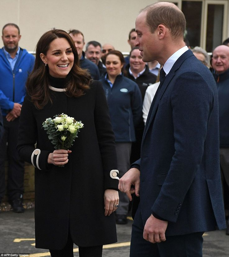 Blooming lovely! Pregnant Kate was glowing as she was handed a small white posy after the ...