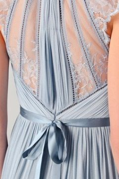 Not sure what the front looks like but the back of this dusty blue bridesmaid dress is delicate and beautiful!