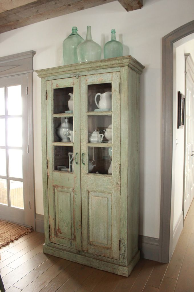 love this old #vintage cupboard dresser and adore the weathered glass bottles on the top...beautiful #faded green paint x  #decorating #shabby #green