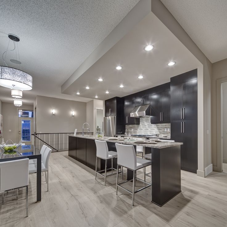 Modern Kitchen Design Calgary: Kitchen - Granite Countertops, And Sumptuous Ceiling Height Charcoal Stained Cabinets