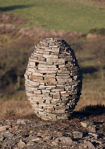 This shows balance in how each of the stones are arranged, supporting and aiding to the sculpture as a whole to provide the desired shaped and symmetry