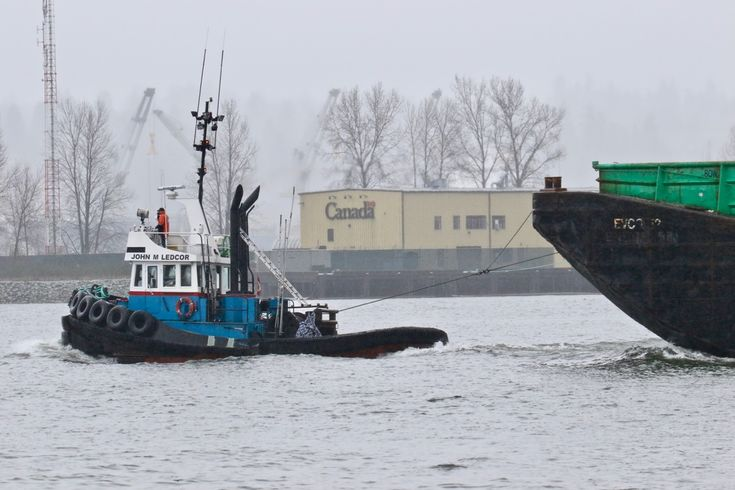 """Ledcor Group's tugboat """"JOHN M LEDCOR"""" tows a barge past Shoal Point on Annacis Island in the Fraser River. Click image to enlarge."""