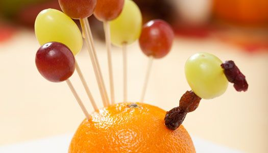 """Thanksgiving guests will """"gobble up"""" these Fruity Turkey Favors. All you need is an orange, toothpicks . . ."""