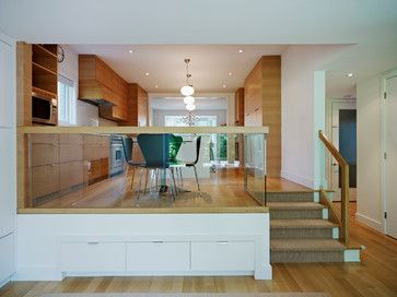 This glass half wall separates the living and dining areas without closing them off!   www.franksglass.com