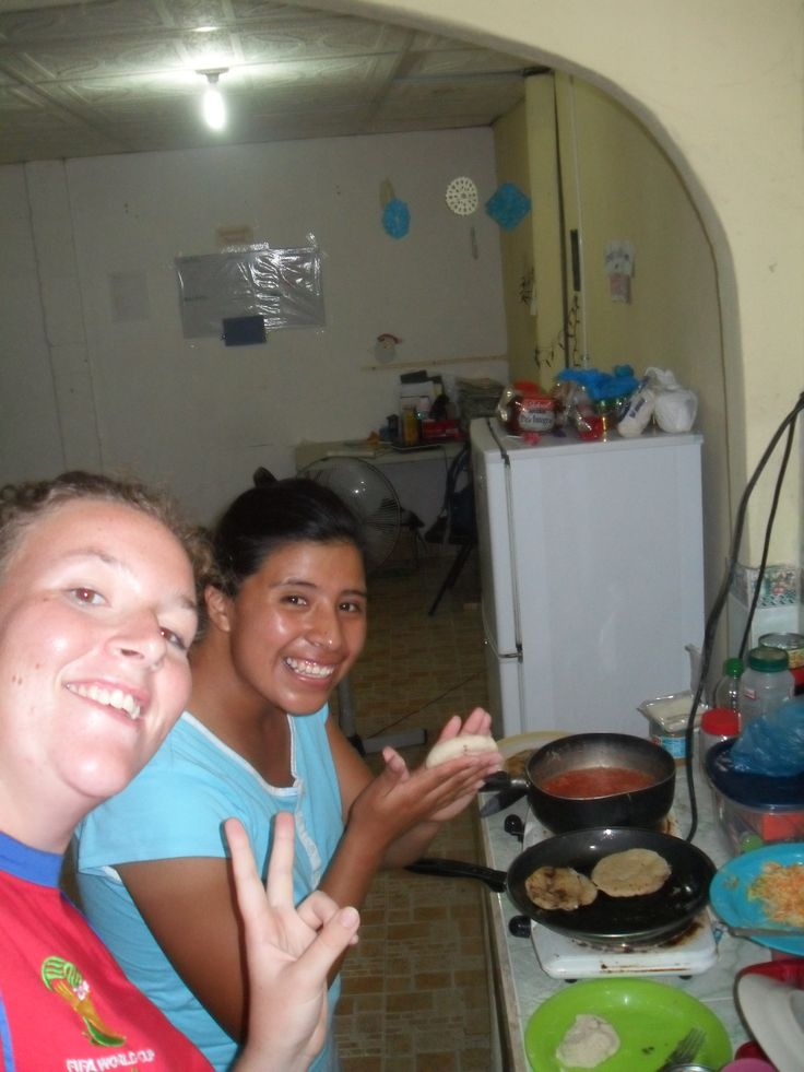 Natalie and Hermana Axjup making pupusas.