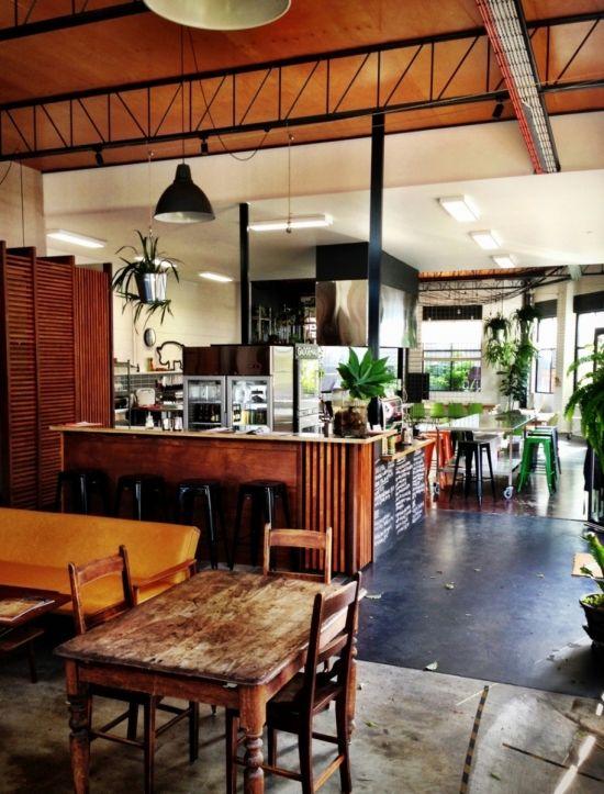 Bar restaurant hospitality interior design timber cafe concrete pendant industrial