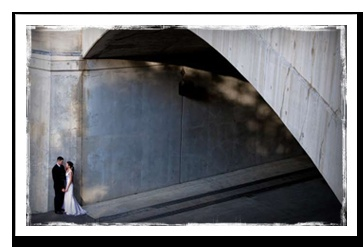 Wedding couple under the bridge near the Chateau Laurier in Ottawa.  Photo by Tripp Photography
