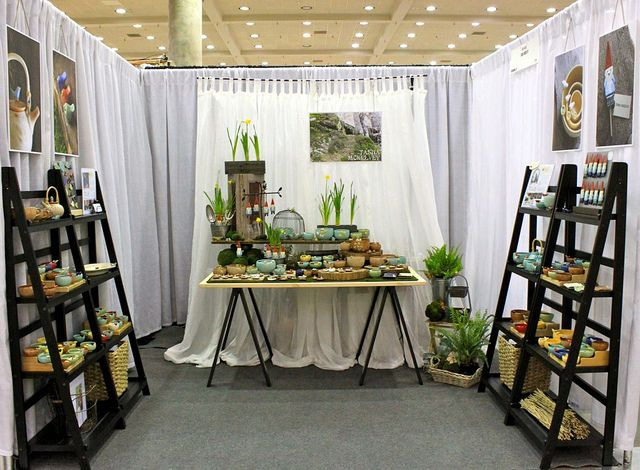 I'm a big fan of Tasha McKelvey's adorable pottery.  And now I'm a fan of her show display, using folding ladder shelves.  Very portable!  (tashamck on Flickr)
