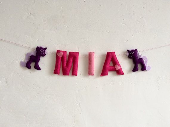 This unicorn name garland is perfect for decorating your childs bedroom or the nursery. It would make a perfect gift for a new baby or decoration for a baby shower, in which case you may prefer to have it made up with the words baby girl instead.  Each of the letters and unicorns are made from felt and measure approximately 10cm high. The name banner has a unicorn at either end with the name strung between. The name shown is for example only, instead it will be made in the name of your…