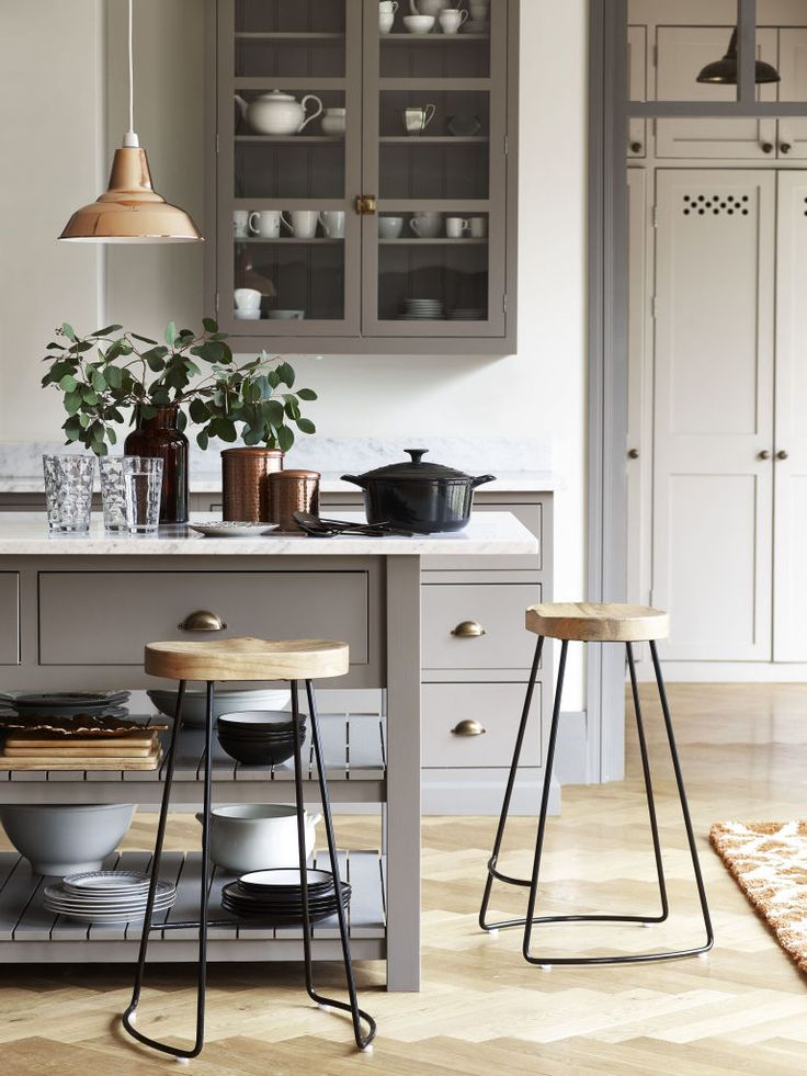 This light and airy muted and pale grey kitchen has a contemporary feel thanks to a copper pendant light and pared back ceramics. (Photo: George Home) #kitchens #kitchendesign #kitchenideas #grey #copper #declutter