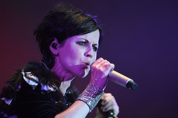 Dolores O'Riordan Photos - Irish singer Dolores O'Riordan of Irish band The Cranberries performs on stage during the 23th edition of the Cognac Blues Passion festival in Cognac on July 07, 2016. / AFP / GUILLAUME SOUVANT - Dolores O'Riordan Photos - 16 of 37