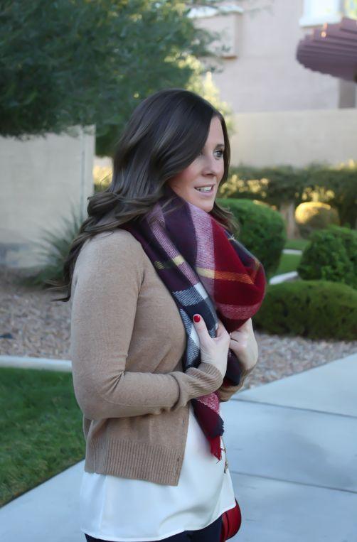 dark jeans, brown boots, crème blouse , red handbag/ scarf. so cute !