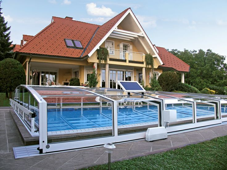 Motorized retractable pool enclosure VIVA by Alukov is equipped with electric sliding system.
