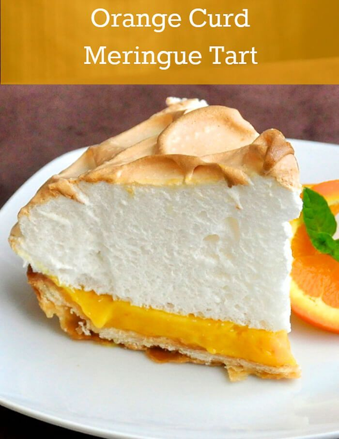 Orange Curd Meringue Tart - a sweet and tart orange curd inside a flakey pastry crust topped with a mountain of fluffy meringue. A delightful dessert to serve at dinner parties or even Sunday supper.