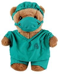 "Dr. Scrubz measures 10"" tall. Comes wearing teal scrubs with a matching scrub mask and cap. #scrubs.com"