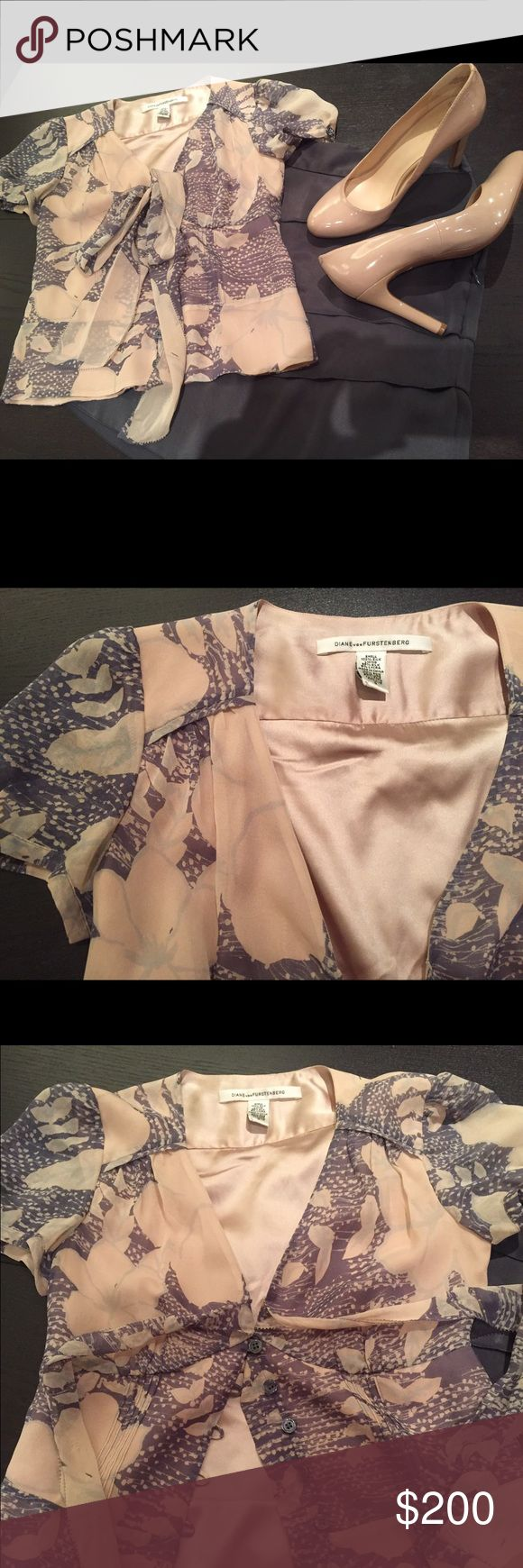 Gorgeous, rare Diane von Furstenberg silk top This is your opportunity to buy one of a kind top at a joke price. Blush and slate color. Worn only once at a wedding. 100% silk that flows like the Bahamas breeze. Fitted to give you a marvelous figure. Front buttons. No flaws! Pet & smoke free. Make an offer!! Diane von Furstenberg Tops Blouses