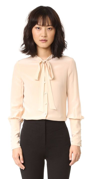 On SALE at 50% OFF! Lucy Top by BELSTAFF. Blouson sleeves and extended cuffs add victorian inspired detail to this silk Belstaff blouse. Sashes tie at the neck...