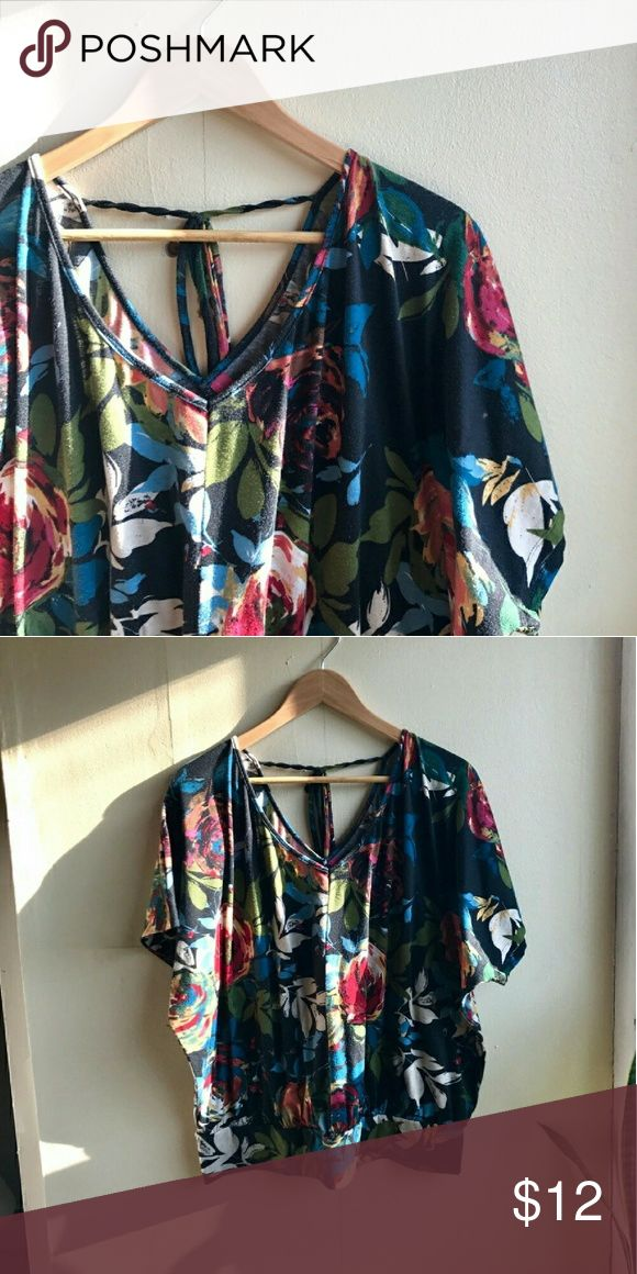 """Pure Energy Floral Plus Size Top Absolutely gorgeous floral top with a tie detail at the base of the neck. Perfect for your spring/summer wardrobe. Excellent used condition!  95% Polyester,  5% Spandex. Wash cold,  tumble dry low.  Length: approx 26"""" Bust: approx. 29"""" (slight dolmen slouchy style) Measurements taken flat.   🔸Offers welcome!  🔸20% off bundles 🔸Same or next day shipping Pure Energy Tops Tees - Short Sleeve"""