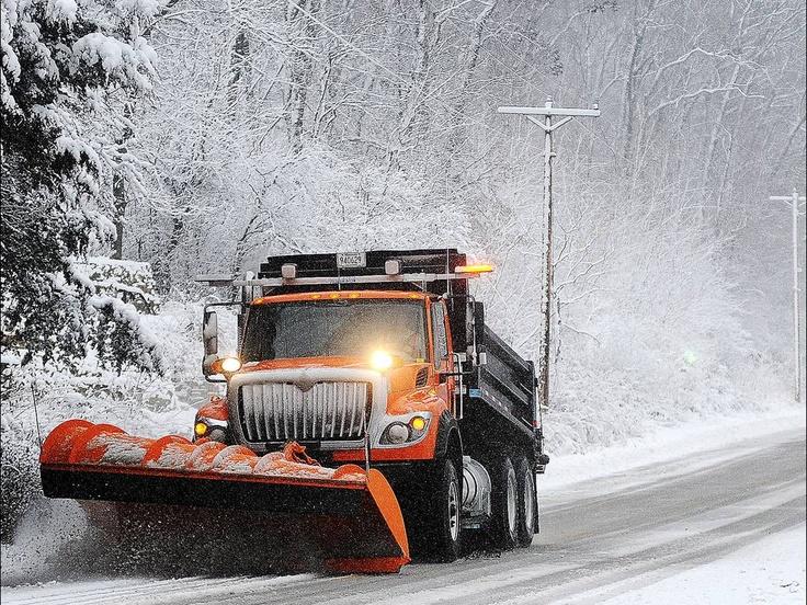 A snow plow clears Old Homer Road near Winona, Minn. Joe Ahlquist, via AP