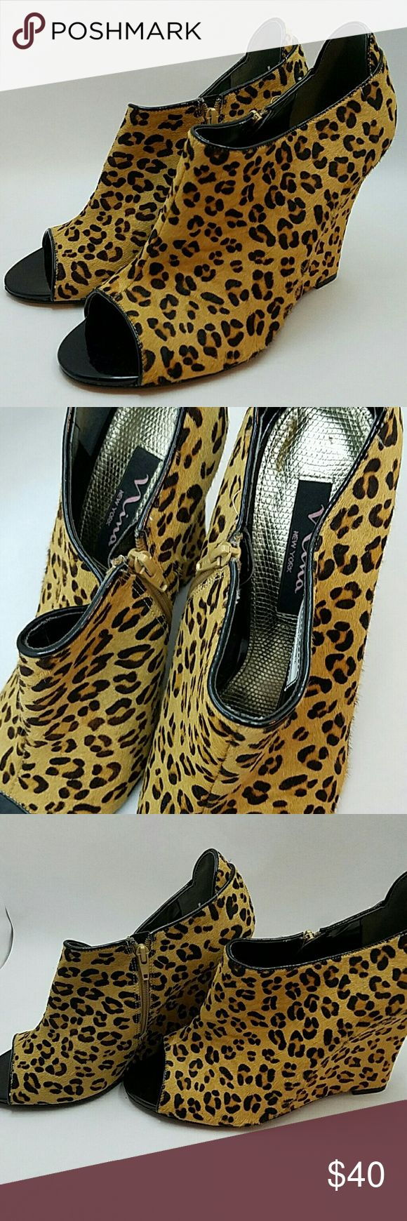 Nina New York calfskin animal print wedges These designer peep toe wedges are classy and edgy meaning you can wear them with a preppy cardigan or a leather jacket! Dress them up or pair them with professional attire for work, a LBD for the club, or some jeans for everyday wear: they're so versatile!! Nice to the touch, they're made from real calfskin fur and feature the always popular cheetah print. Super comfortable the inside is soft and padded and zips up the side for easy on/off. Nina…