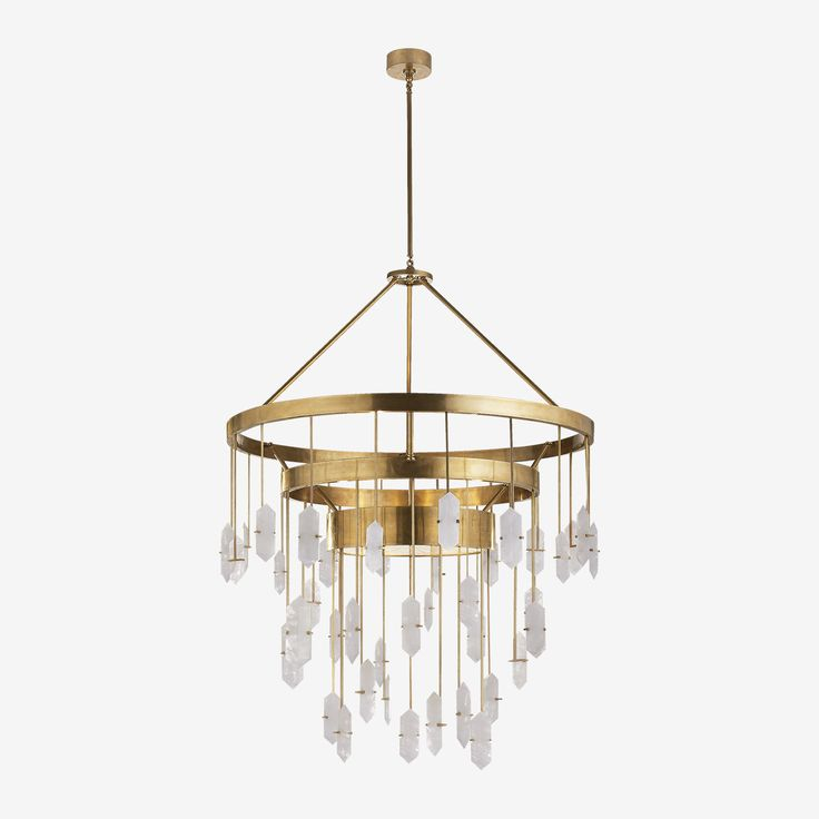 The Halcyon Chandelier in Antique Burnished Brass with Quartz by Kelly Wearstler • One seriously stunning statement-maker, the Halcyon Chandelier is composed of hand-selected solid natural quartz stones and a sculptural brass frame. Graceful yet edgy, its subtle refinement and soulful sense of cool adds spirit and dimension to any space - it's the kind of light fitting that will stop anyone in their tracks, measuring over 2 metres in height and almost 1 metre in width.