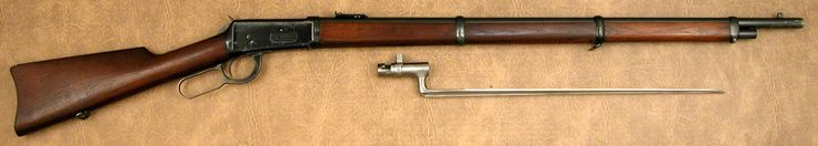 "Winchester 1894 Musket .30 WCF s/n 503008 mfg 1909  - 30"" round barrel; full mag; carbine- style rear sight graduated to 200 yards; square base front sight base/bayonet lug; straight grain walnut stocks w/full forend and three barrel bands; smooth case colored carbine/musket style buttplate w/no trap door; sling swivel in buttstock and in middle barrel band; angular bayonet."