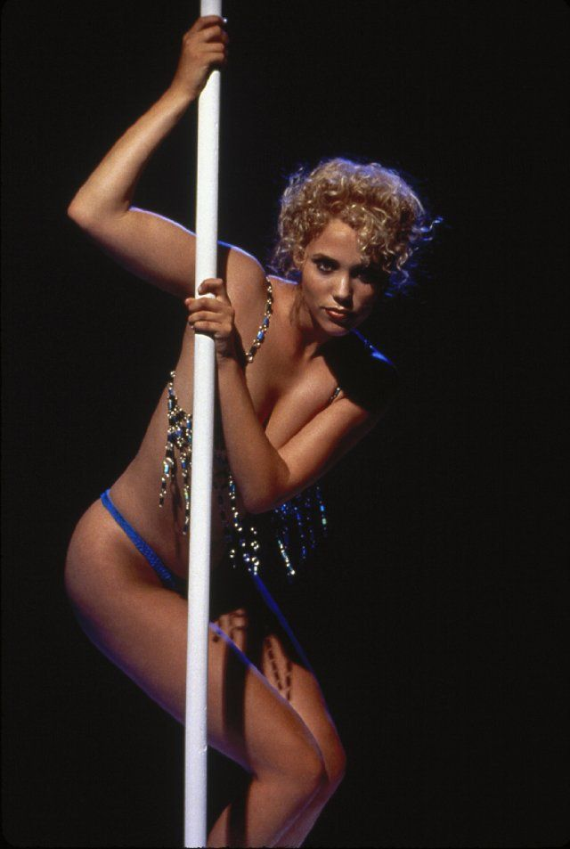 Pin for Later: 25 Iconic Stripper Moments in Pop Culture Elizabeth Berkley as Nomi Malone in Showgirls, 1995