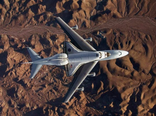 Carla Thomas, Nasa/Reuters:The shuttle Endeavour, deft in orbit but incapable of terrestrial flight, catches a post-mission piggyback on a 747, soaring over California's Mojave Desert en route to Florida's Kennedy Space Center, June 2009.    #Carla Thomas #NASA