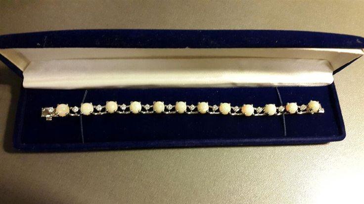 Annons på Tradera: RARITET Armband 18K., med 12 oval Cabuchon slipade Opal, 12st., VIKT 31,2gr.