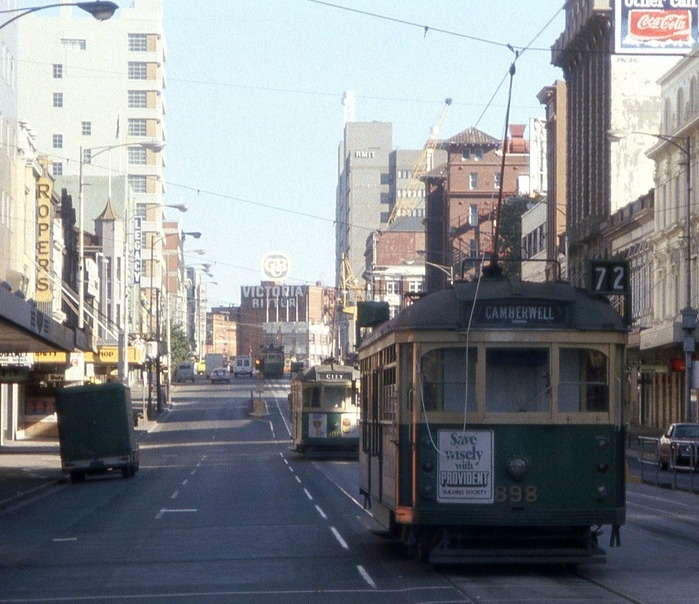 Swanston St Melbourne late 1970s. It;s amazing to think that this street hardly resembles this picture in 2013. Sure it's now a tram and pedestrian thoroughfare i like the older version with the CUB in the distance. In fact give me old melbourne over this current day need to be shiny and all modern with shoeboxes lining the city.