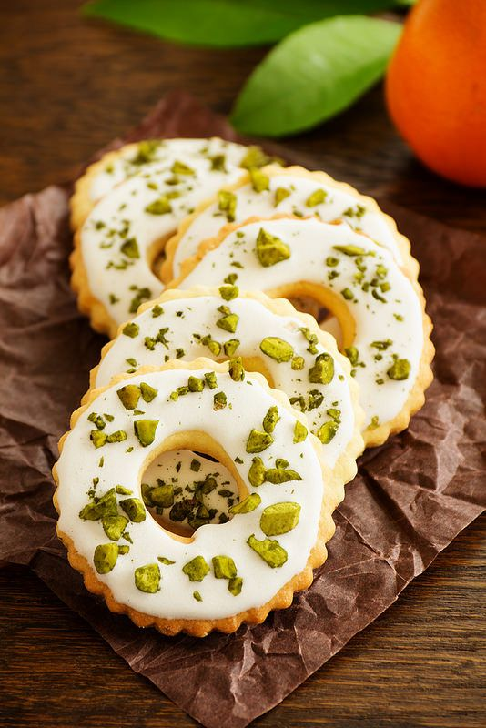Lemon cookies with frosting and pistachios.