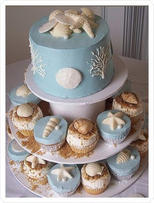 """cakes decorated with """"sand and seashells"""""""