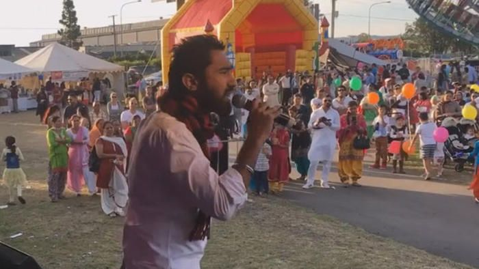 Manmeet Alisher performing at a community concert. (Facebook)