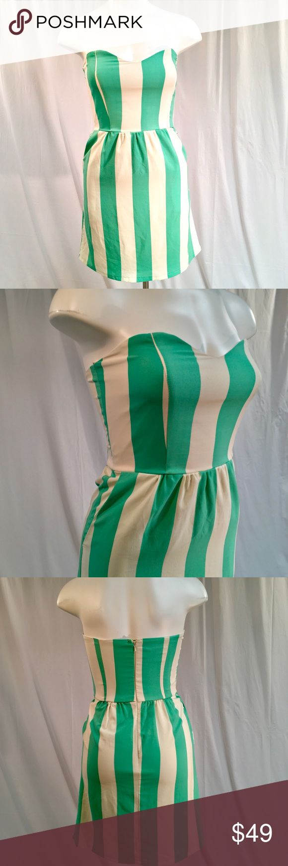 """Judith March Vertical Striped Dress Gorgeous and brand new with tags green and cream vertical stripe dress by Judith March! Has a back center zip closure. Bonding in the bust area. Women's size medium. Overall length is approx 29"""". Judith March Dresses Strapless"""