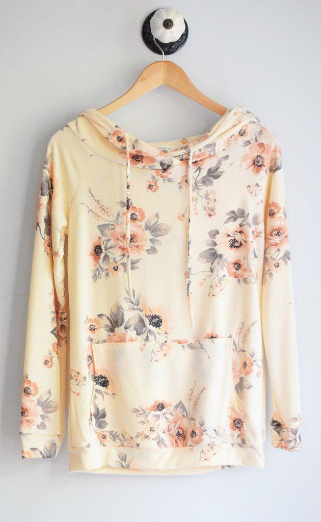 Floral pullover hoodie with front pocket and loose hood. Ultra comfortable. Made in USA 60% polyester, 35% rayon, 5% spandex handwash
