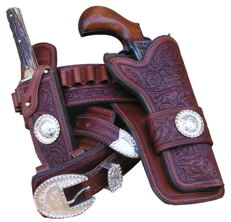 This gun rig makes a statement, the hand engraved sterling appointments are offset by the hand tooled, antiqued leather. Perfect your favorite single six. Holster and belt are fully lined and the sheath is custom made to fit your favorite knife. Price include sterling silver buckle set, conches, holster, gunbelt, and knife sheath. $950
