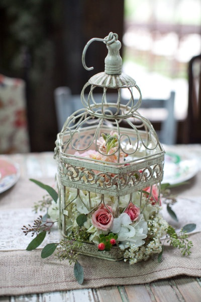 floral bird cage makes a nice simple center piece.