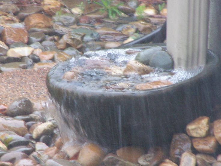 Rain Downspout Catch Basin In Action During A Downpour