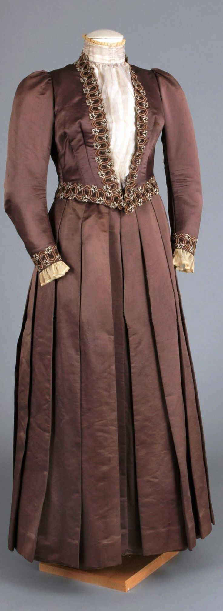 Wedding dress (two bodices & skirt) ca. 1888-91. Muted brown silk satin. The owner, Elizabeth H. Comley Howell (1842-1912), was a doctor who founded the the West Philadelphia Hospital for Women to provide a place where women could be treated by other women. Chester County (PA) Historical Society