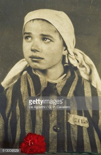 Photo of a little Jewish girl in the Auschwitz concentration camp museum (UNESCO World Heritage List, 1979), Poland.