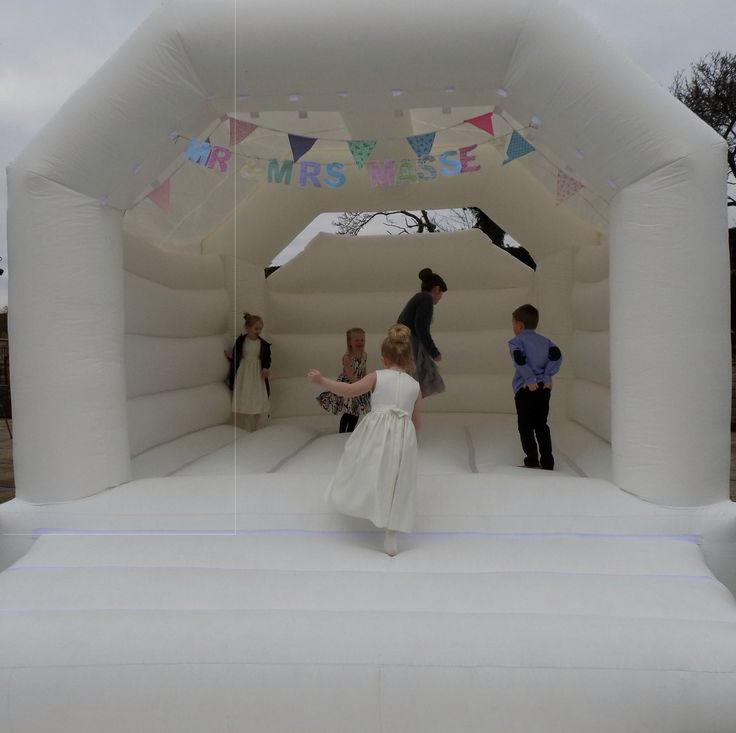 Add bunting to a white bouncy castle