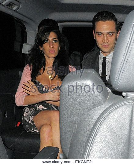 15.JUNE.2010 - LONDON  AMY WINEHOUSE AND NEW BOYFRIEND REG TRAVISS ARRIVING AT…