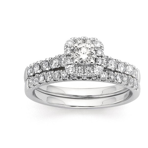 This is a stunning modern 18ct White Gold, Diamond Halo Bridal Set with a Total Diamond Weight of 1ct