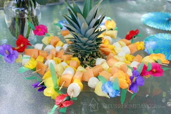 Luau Party Snacks - Fruit kabobs on hibiscus flower skewers from Oriental Trading.